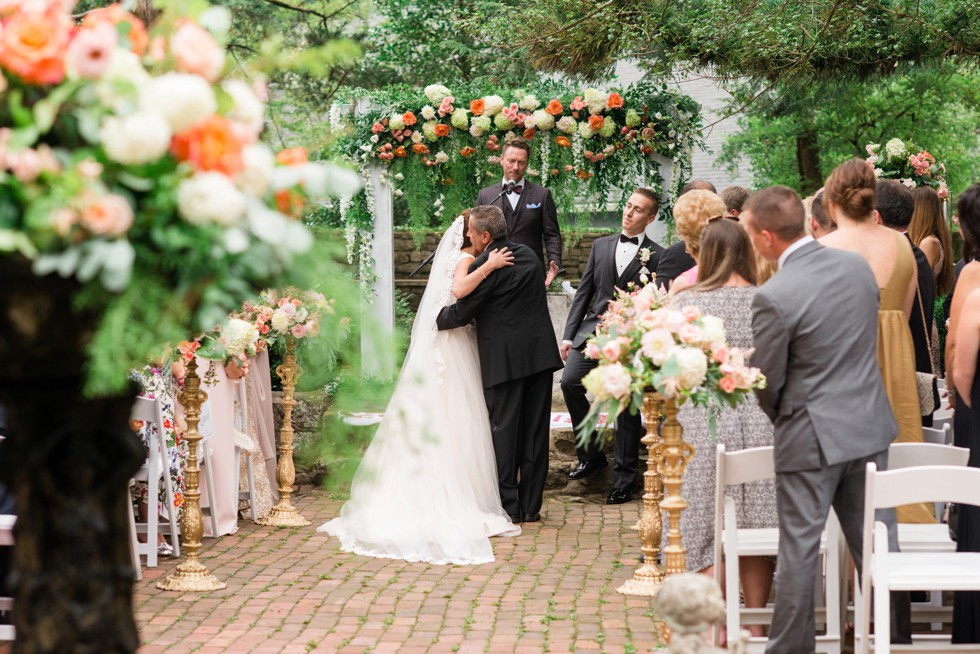 Holly Hedge estate wedding ceremony with rose petals