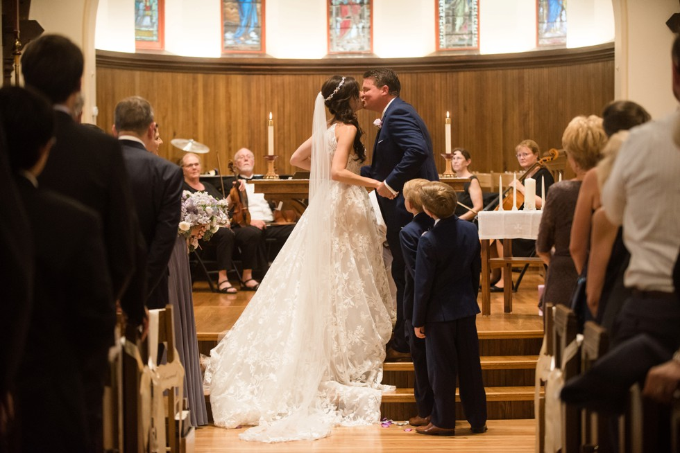 Trinity Cathedral wedding ceremony first kiss