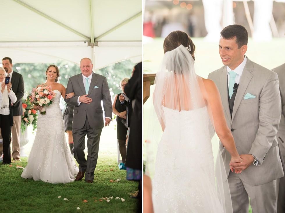 Friendly farm wedding ceremony under a tent