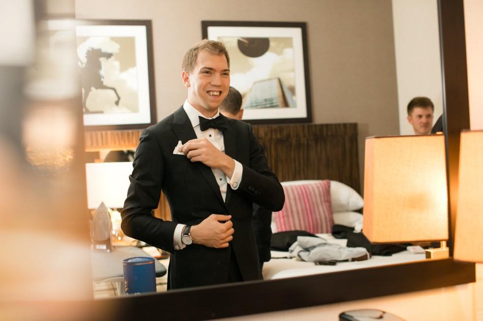 Groom getting ready Delta Hotels by Marriott Baltimore Inner Harbor