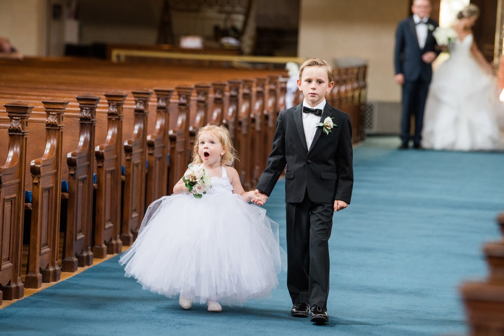 cute flower girl reaction to United States Naval Academy chapel wedding ceremony