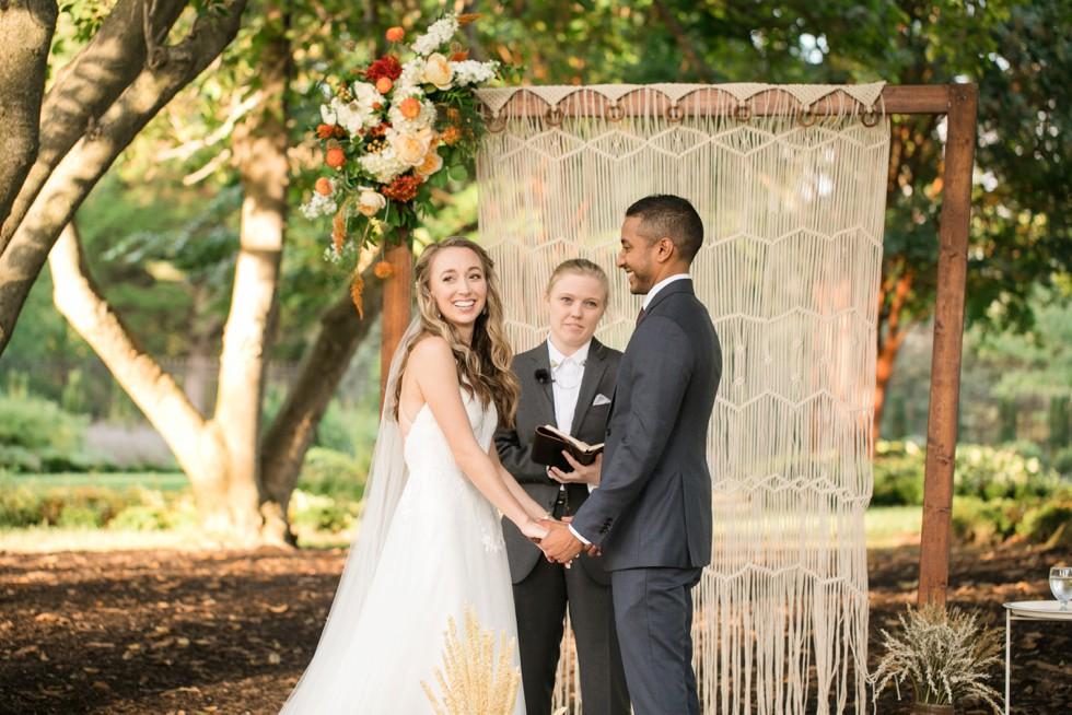 Outdoor fall wedding ceremony Belmont Manor