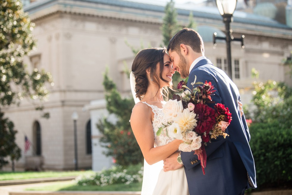 bride and groom in Mount Vernon Place near George Peabody Library