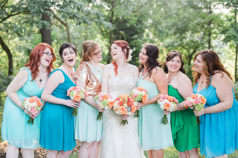 teal bridesmaid dresses - coral bouquets