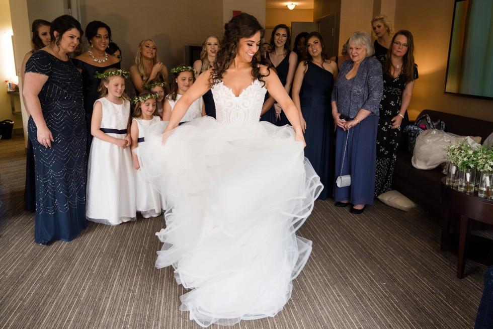 Bride twirling Westin Annapolis Hotel suite