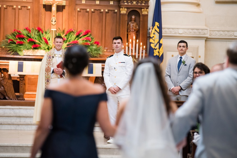 grooms first look in USNA Chapel