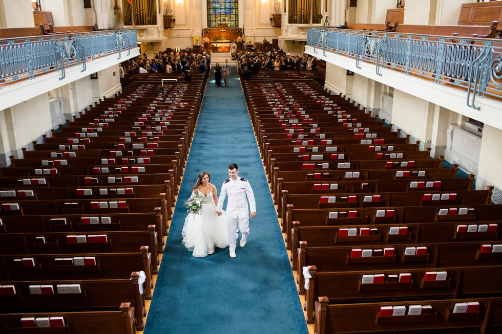 bride and groom walking down USNA Chapel aisle