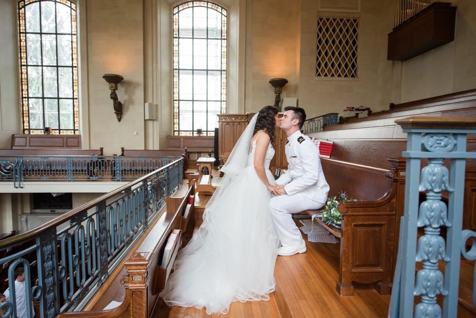 bride and groom overlooking USNA Chapel