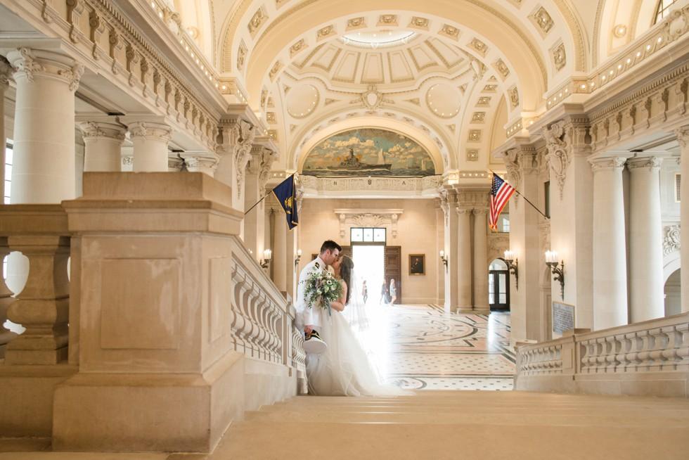 Bancroft Hall grand staircase USNA wedding couple