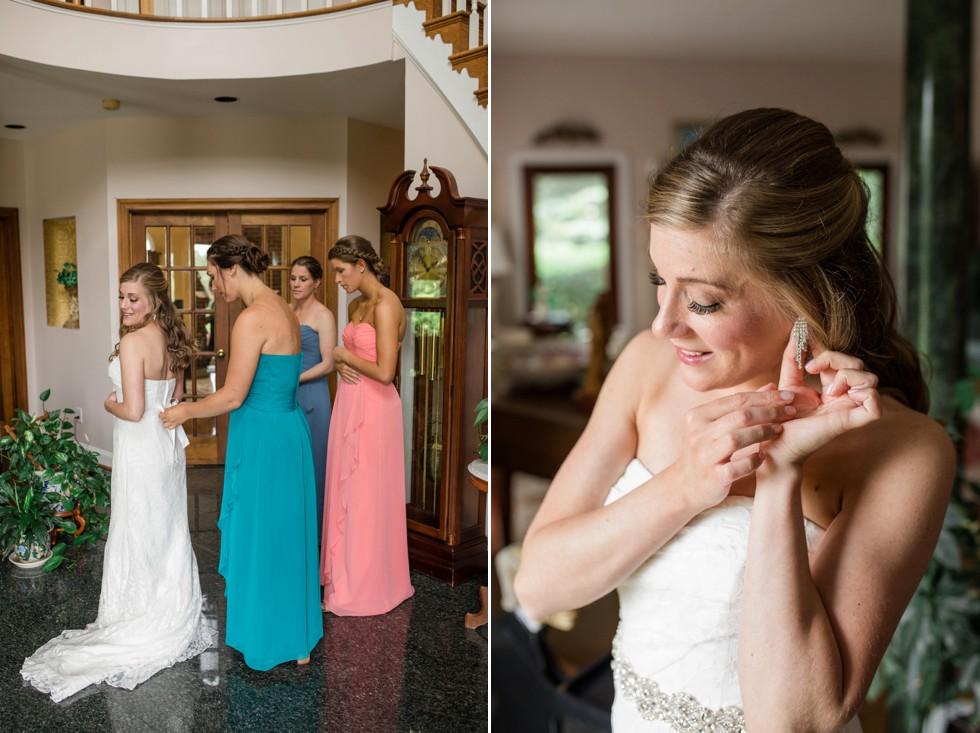 bride putting on wedding gown