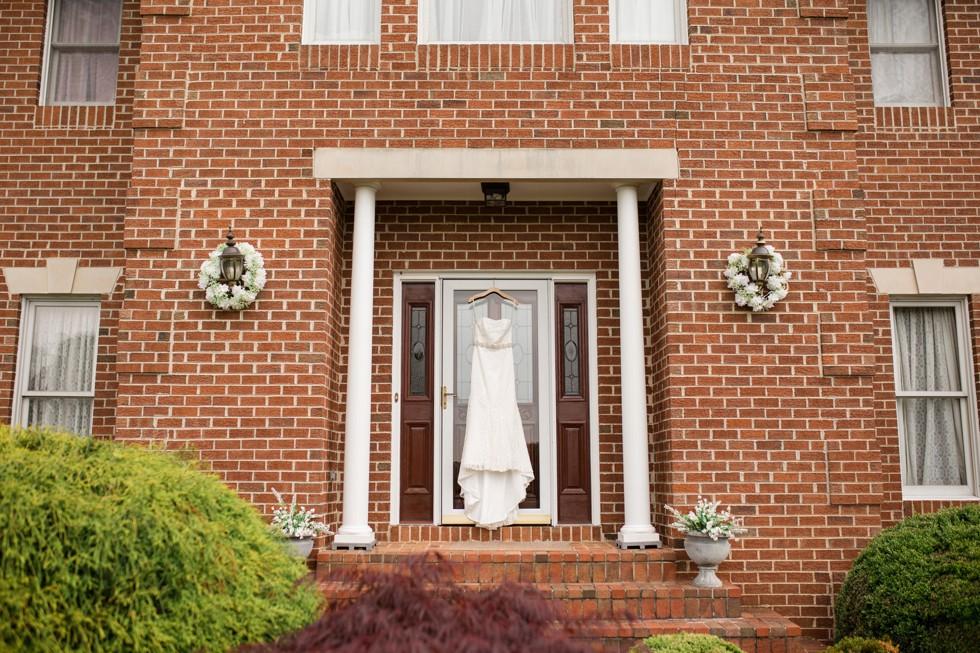 bridal dress on a brick house