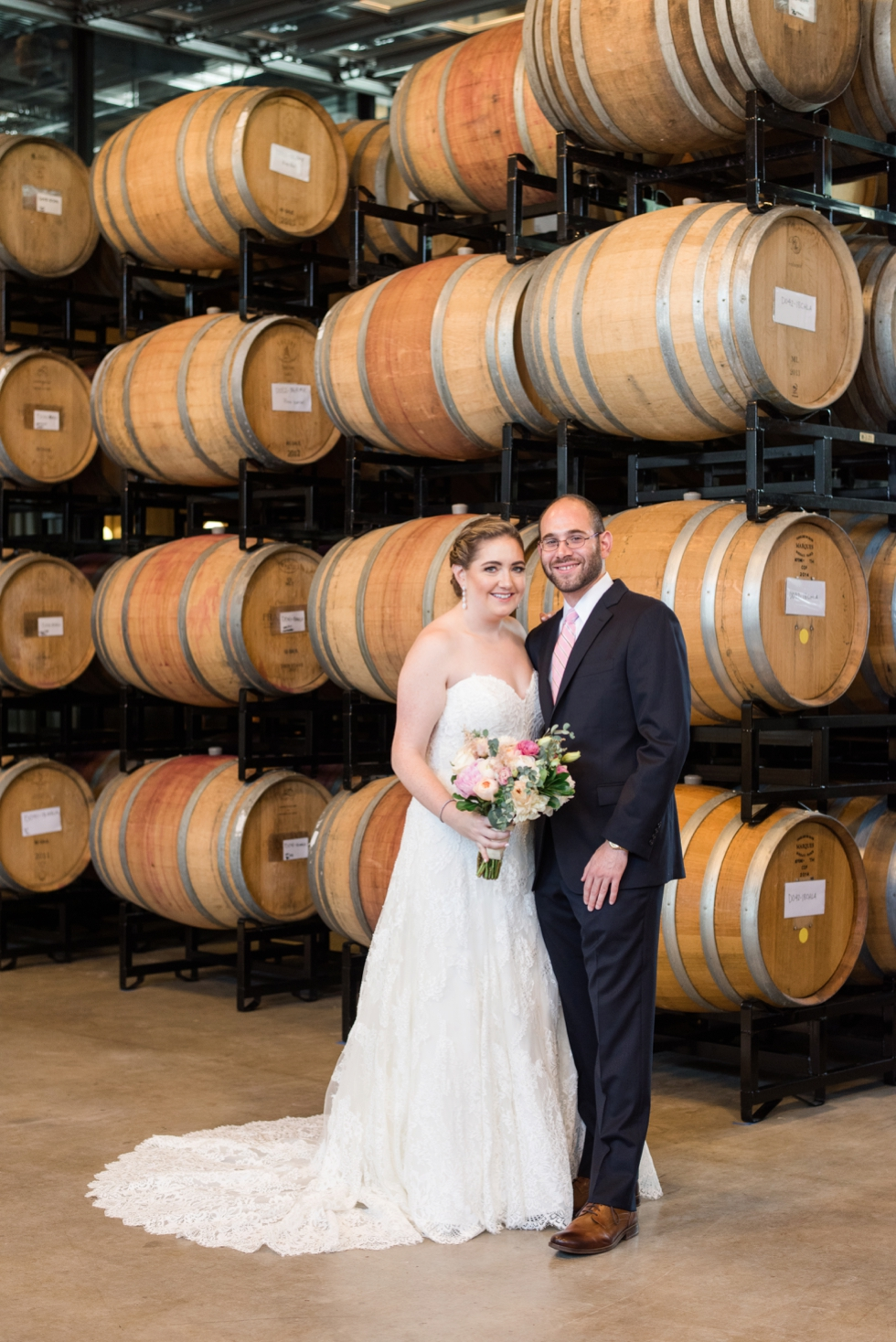 District Winery barrel room bride and groom
