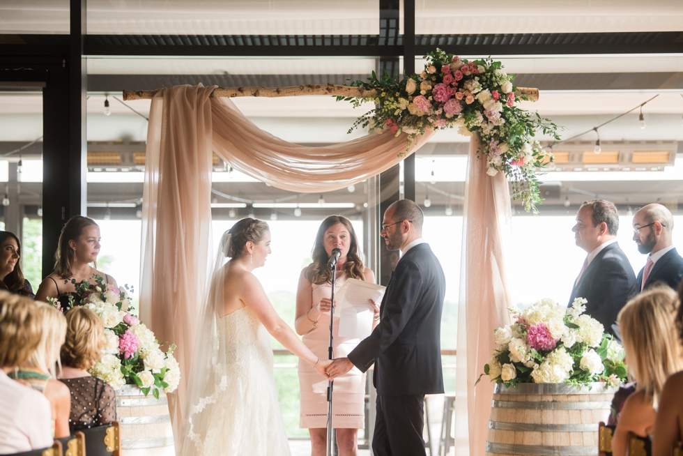 District Winery indoor ceremony J Morris Flowers chuppah