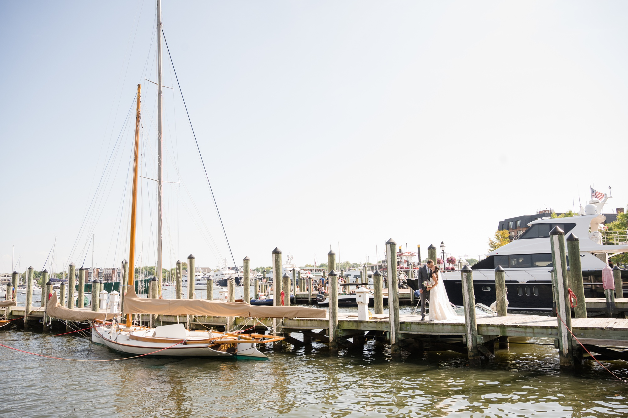 Downtown City Dock Annapolis wedding couple photo with boat
