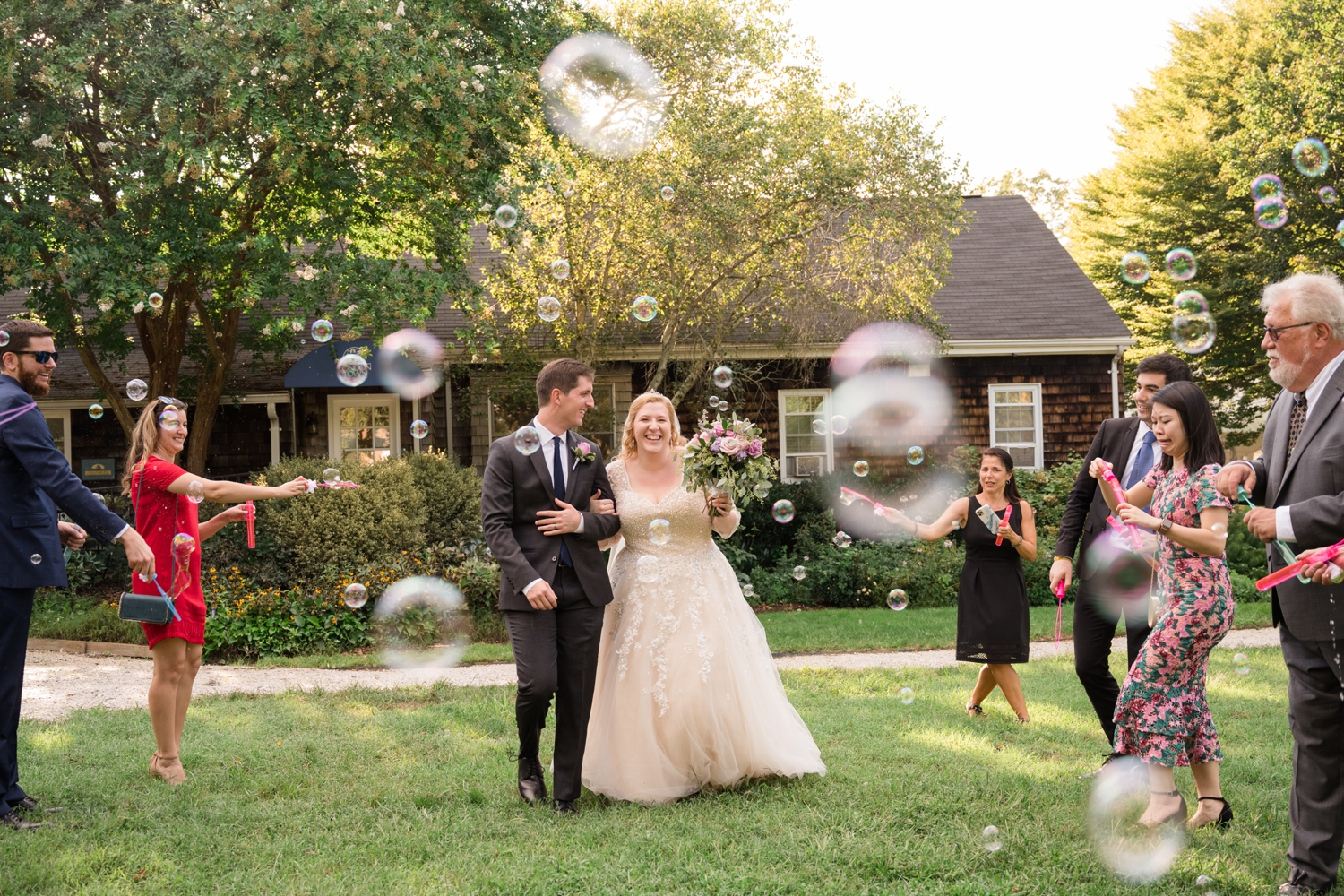 Annapolis Elopement and Micro wedding couple running through bubbles