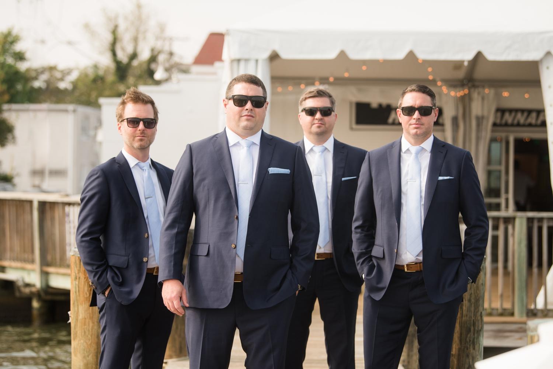 Groom and groomsmen on a dock