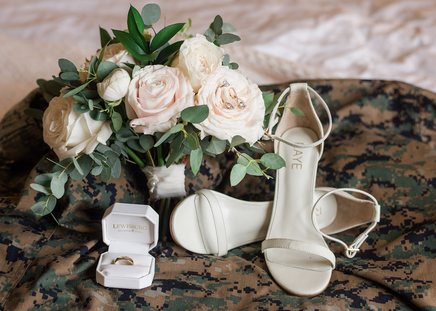 ivory wedding day heels pictured with the bridal bouquet and wedding ring