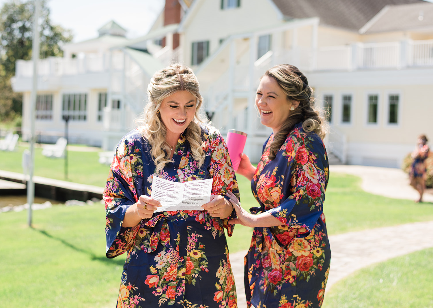 bridesmaids reading a letter and laughing