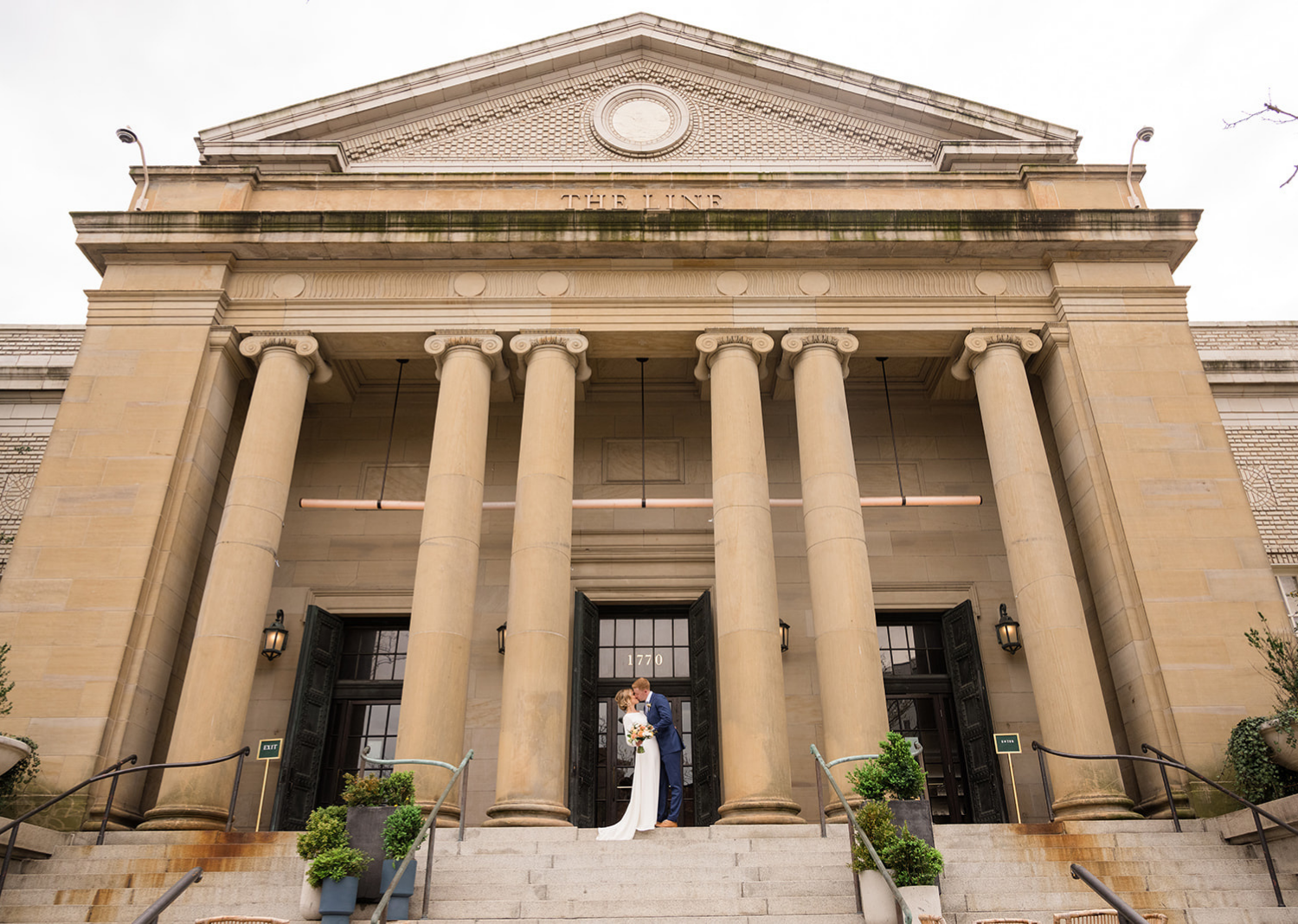 bride and groom stand in front of the line hotel in washington