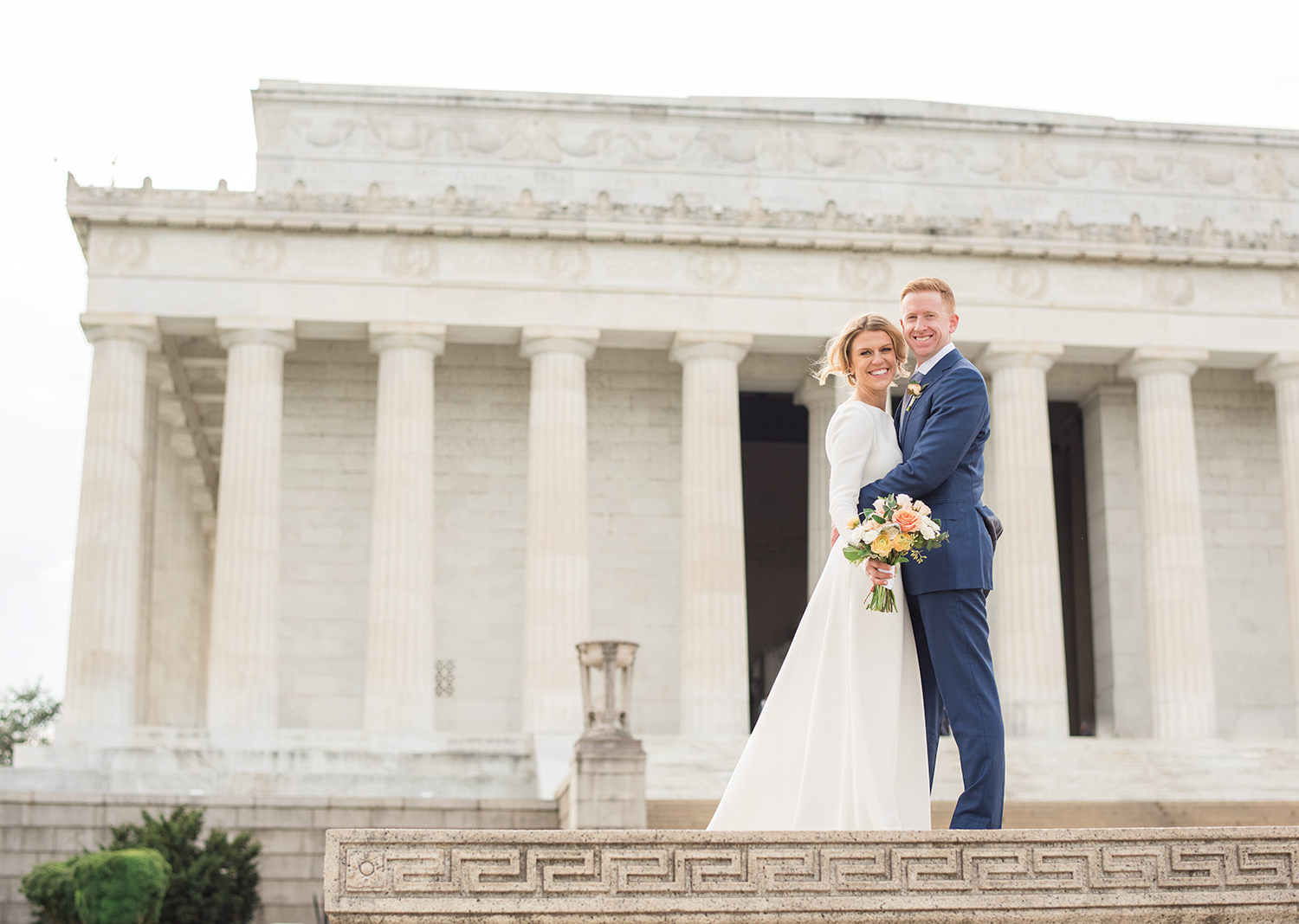 bride and groom in front of the Lincoln memorial