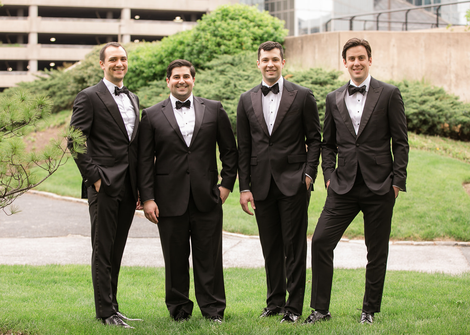 groomsmen smiling with the groom