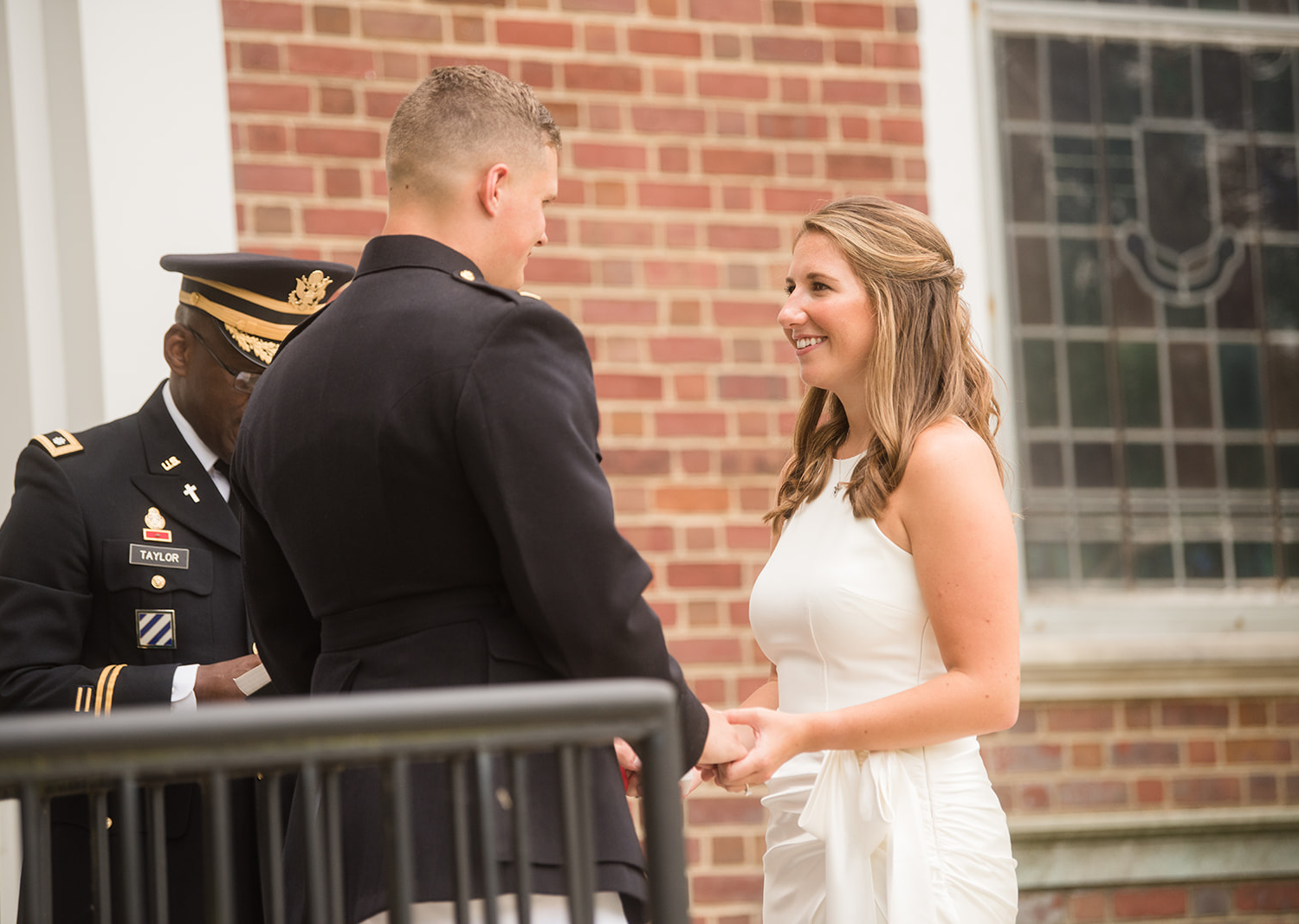 bride and groom smile as they look at each other
