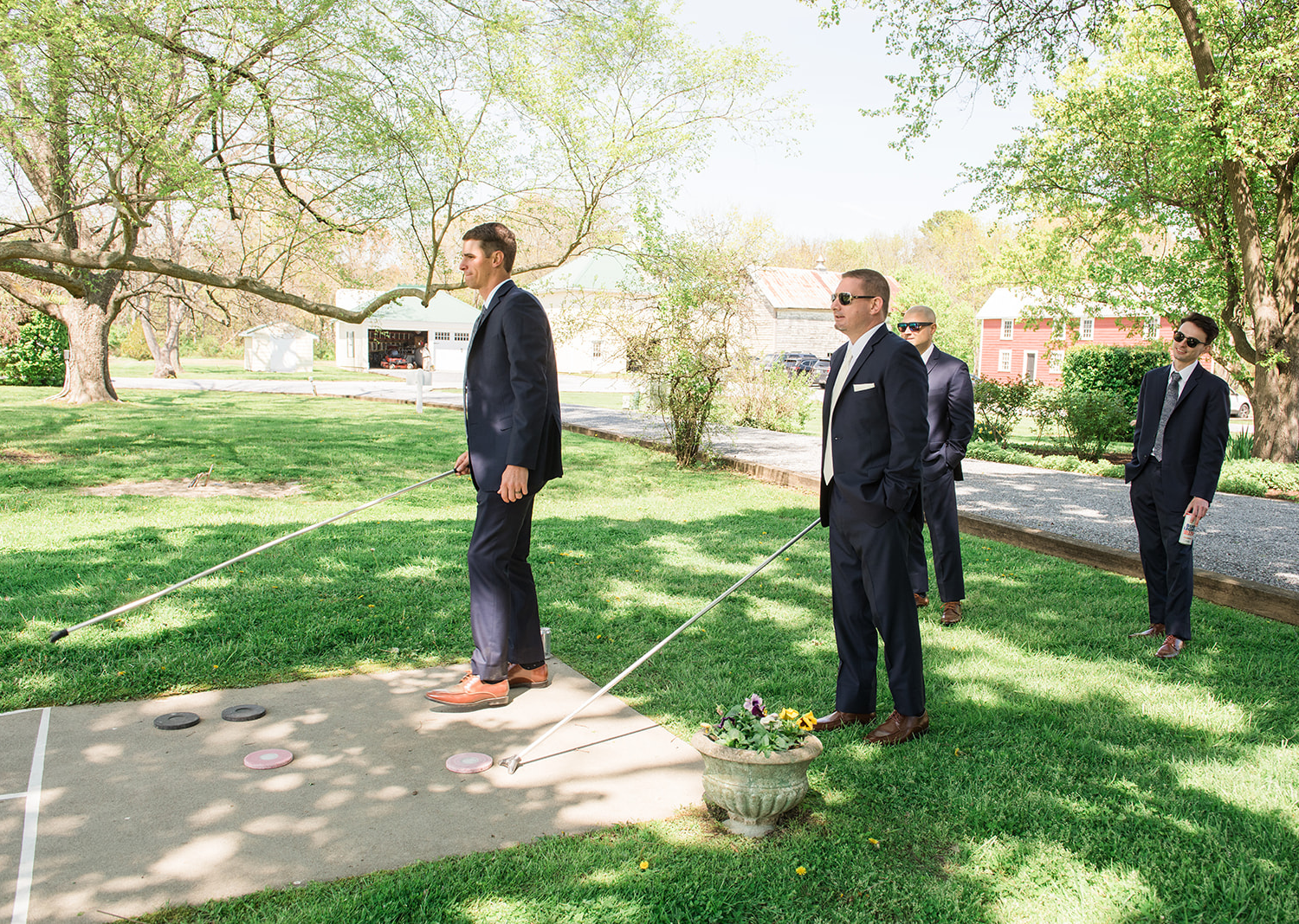 groomsmen playing outside before the wedding