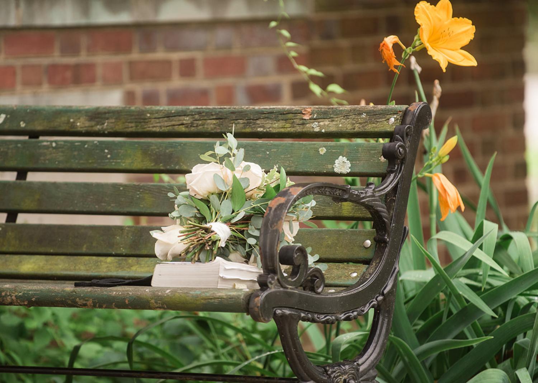 wedding bouquet on a park bench