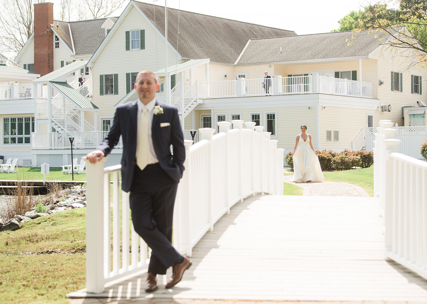 groom smiles as he waits for his bride to come for their first look