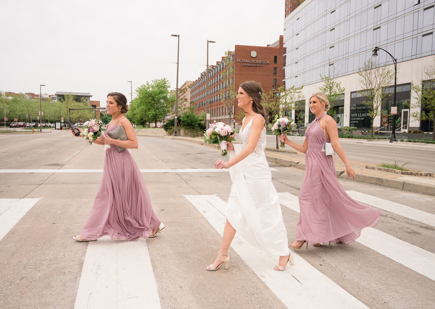 bridesmaids and bride crossing the street in front of the Belvedere Hotel