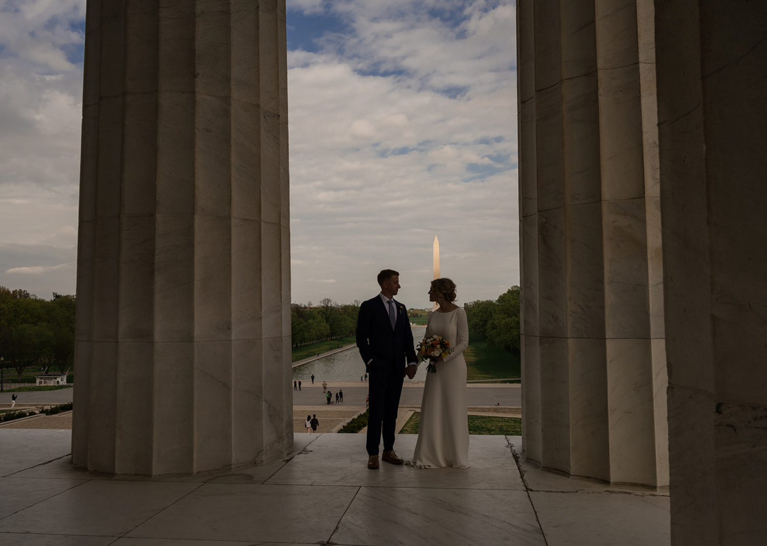 bride and groom pose at the Lincoln memorial