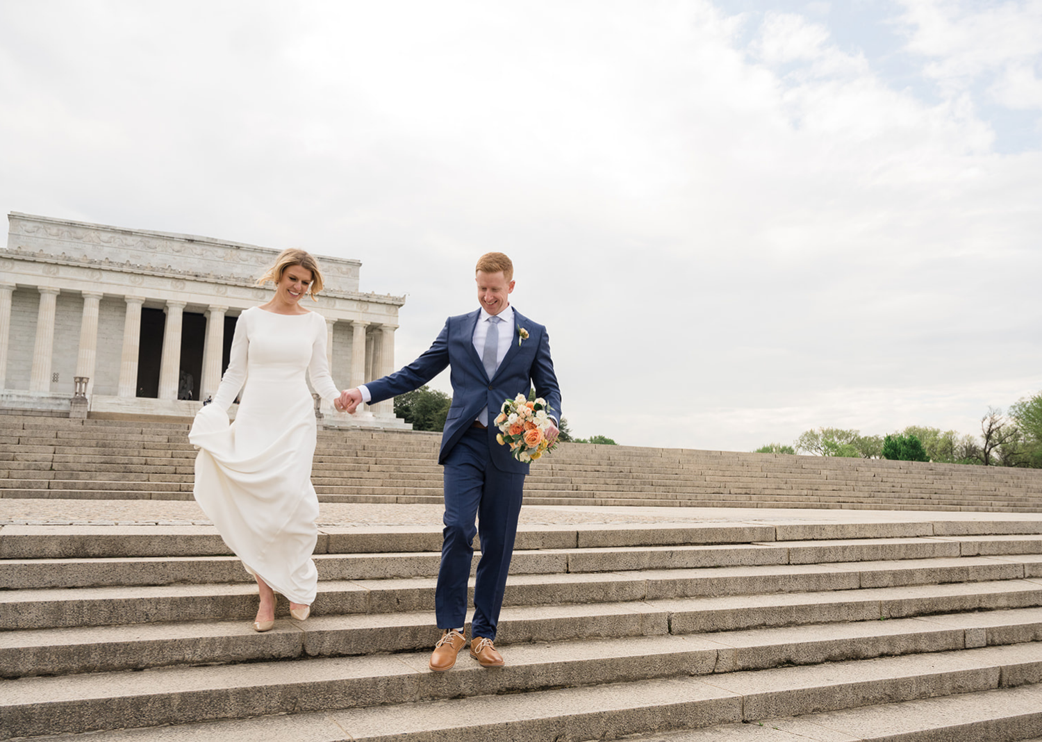 bride and groom run down the steps of the lincoln memorial