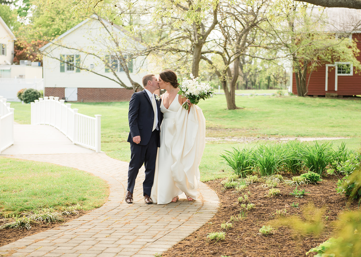 bride and groom share a kiss as they are walking to their wedding ceremony