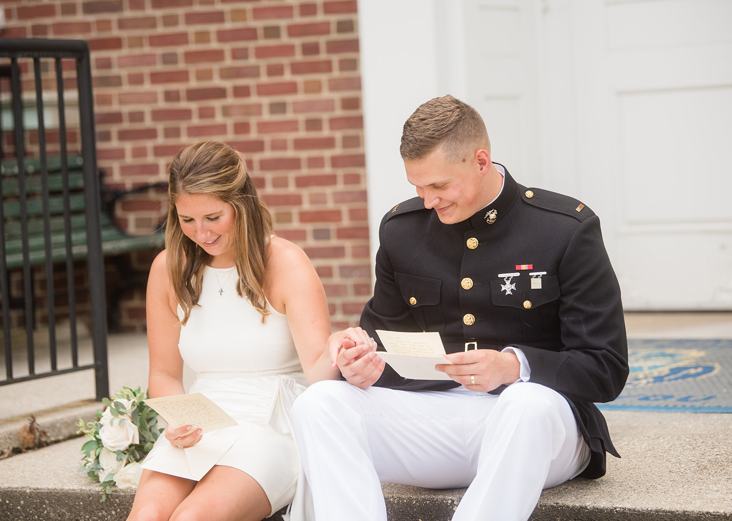 bride and groom reading letters they wrote to each other for their elopement day