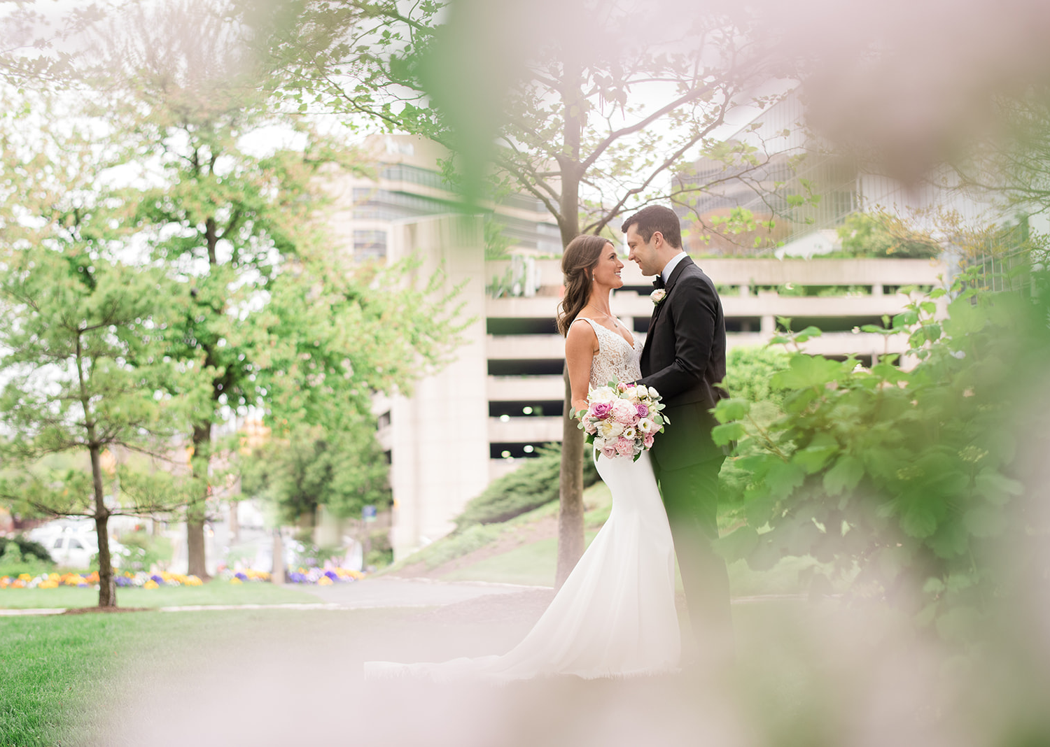 bride and groom romantically look at each other