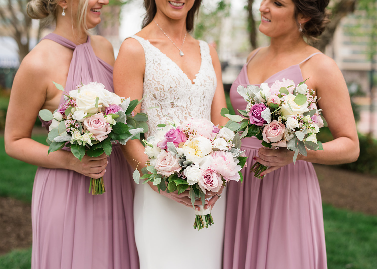 a close up shot of the bride and bridesmaids wedding day bouquets