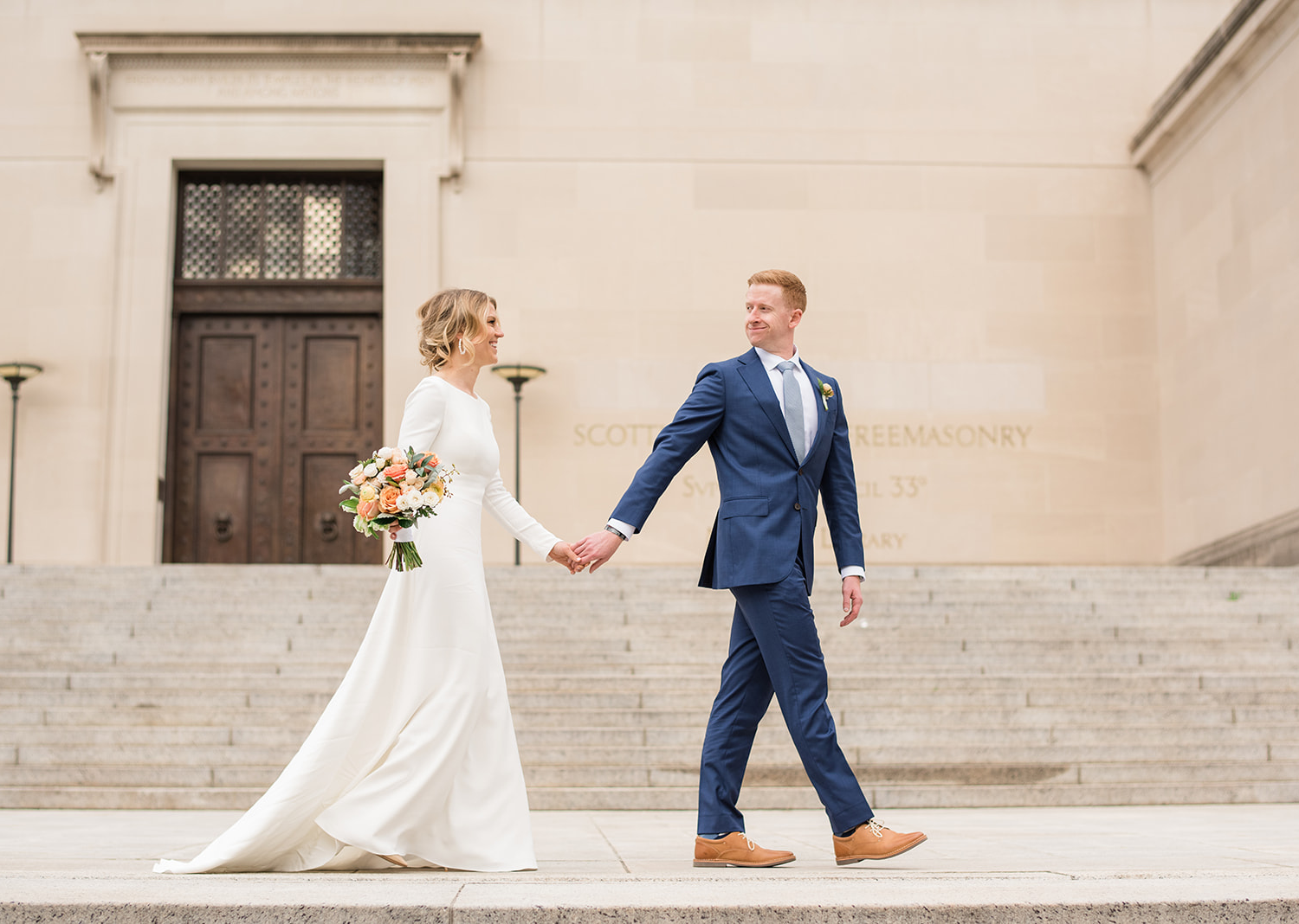bride and groom take a stroll in the national mall in Washington D.C