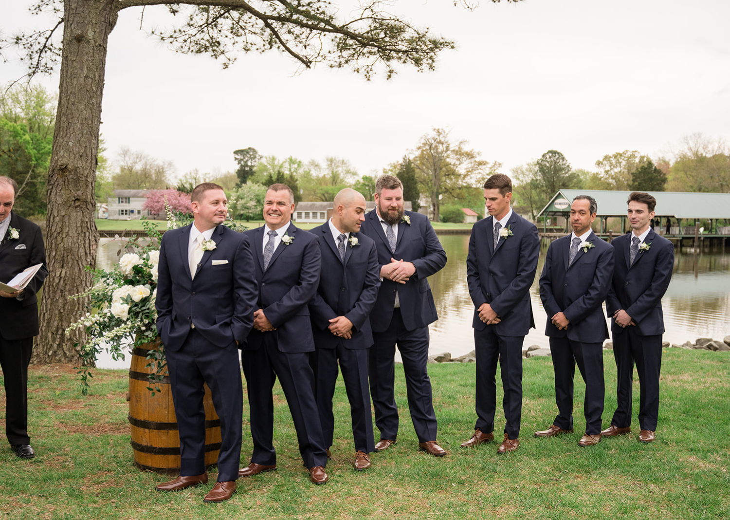 groom and groomsmen stand waiting for the bride during their wedding ceremony