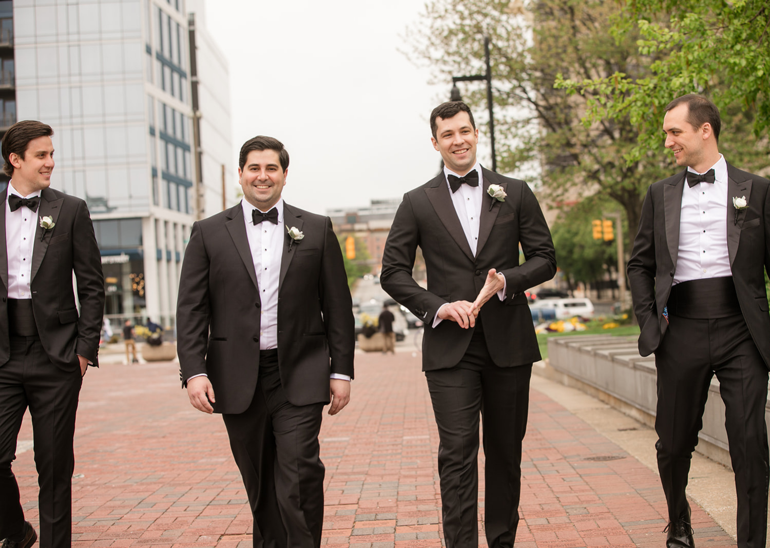groom taking a stroll with his groomsmen