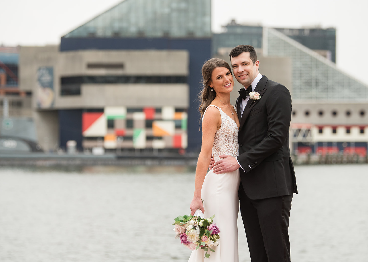 bride and groom wedding day portraits in front of a lake