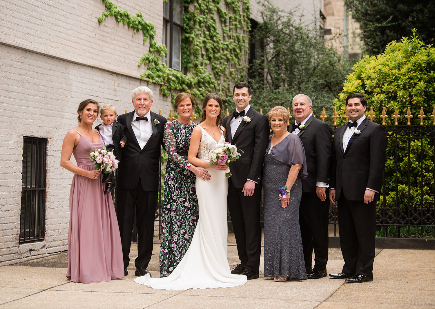 bride and groom stand with their wedding party