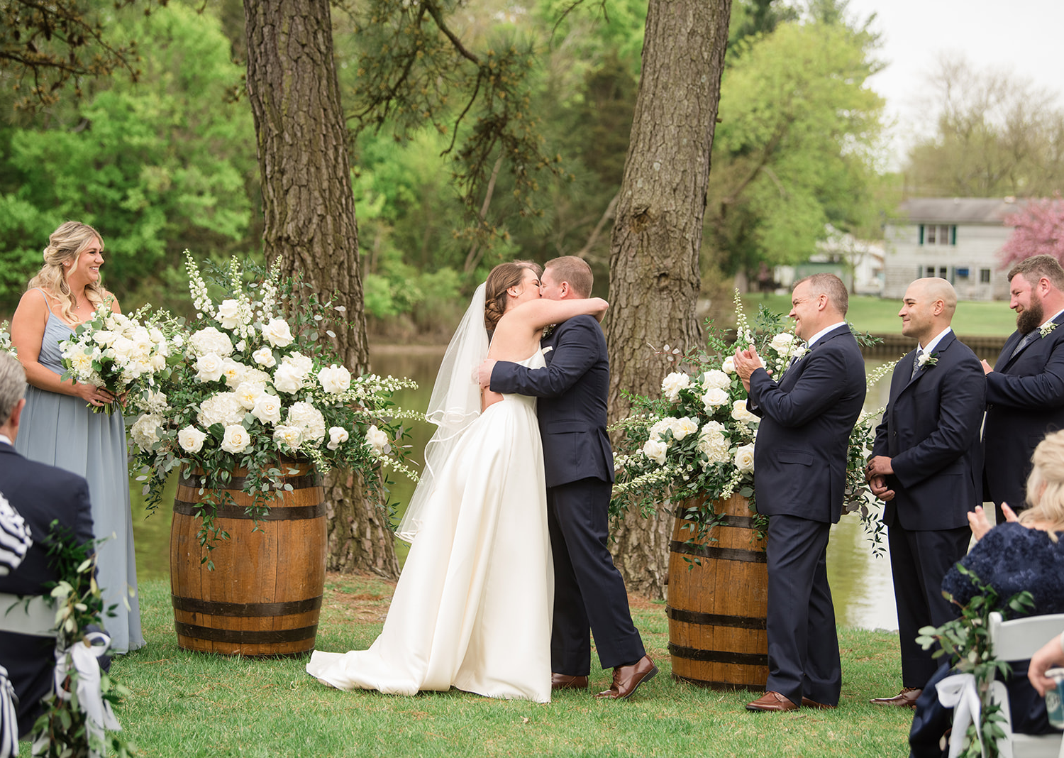 bride and groom share a kiss as husband and wife