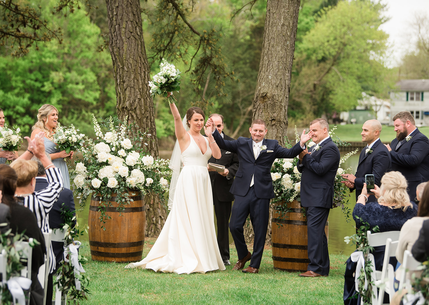 bride and groom celebrate as they are finally announced husband and wife