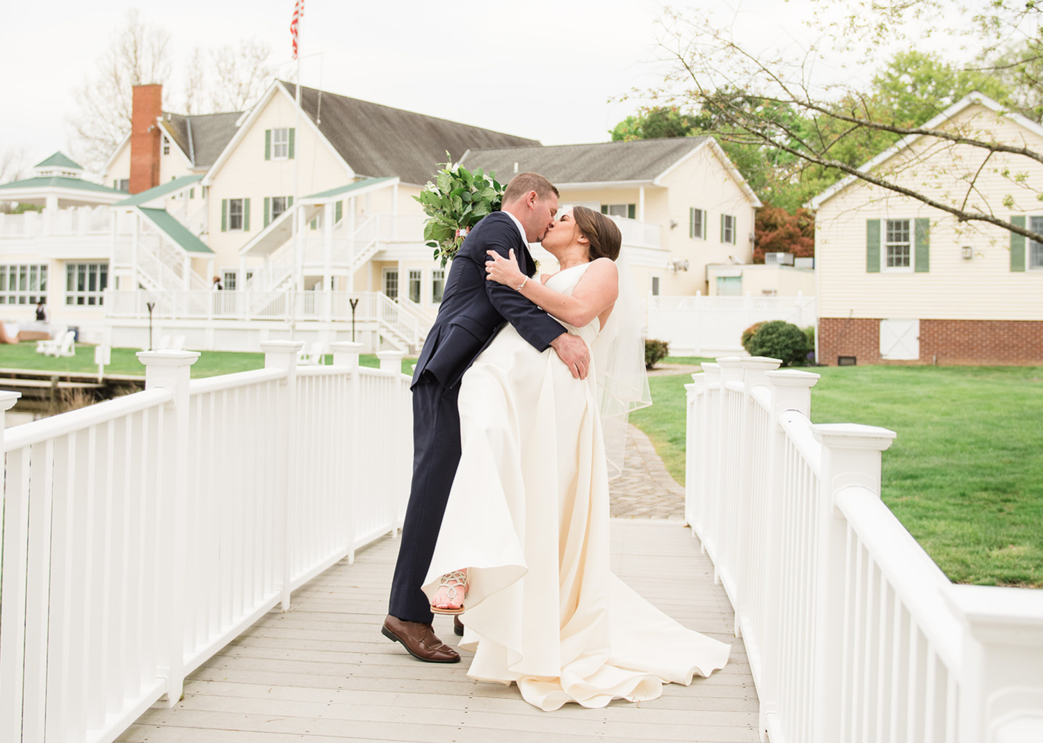 bride and groom share a kiss after their wedding ceremony