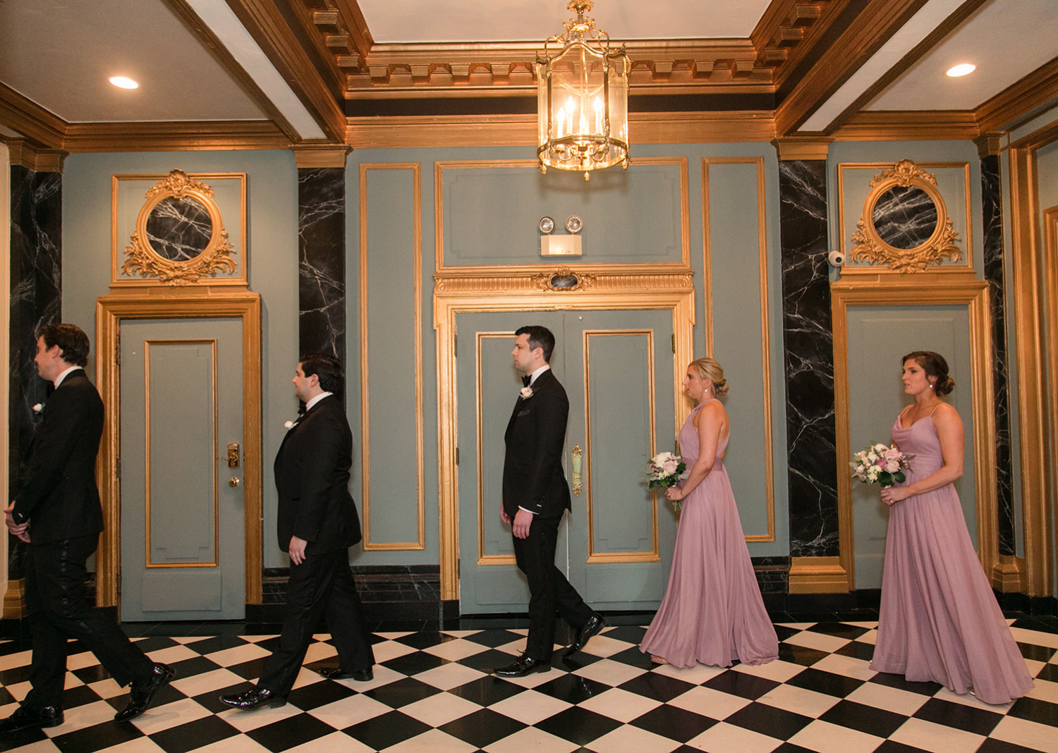 wedding party wait to make their entrance for the wedding at the Belvedere Hotel