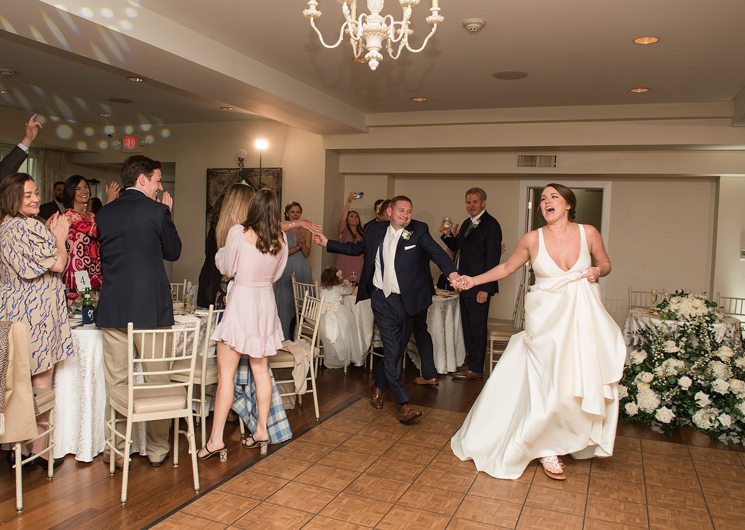 bride and groom make their grand entrance during their wedding reception