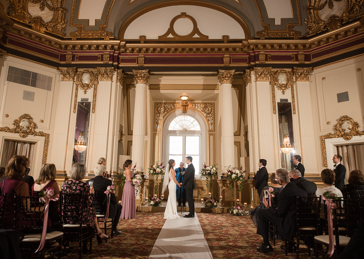 bride and groom during their wedding ceremony at the Belvedere Hotel