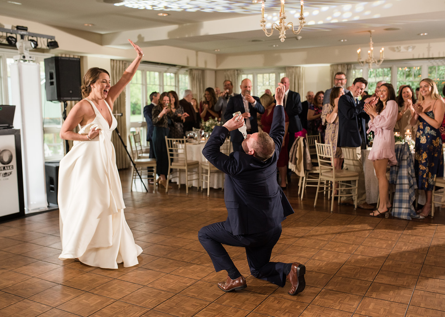 bride and groom having fun as they dance for their first dance