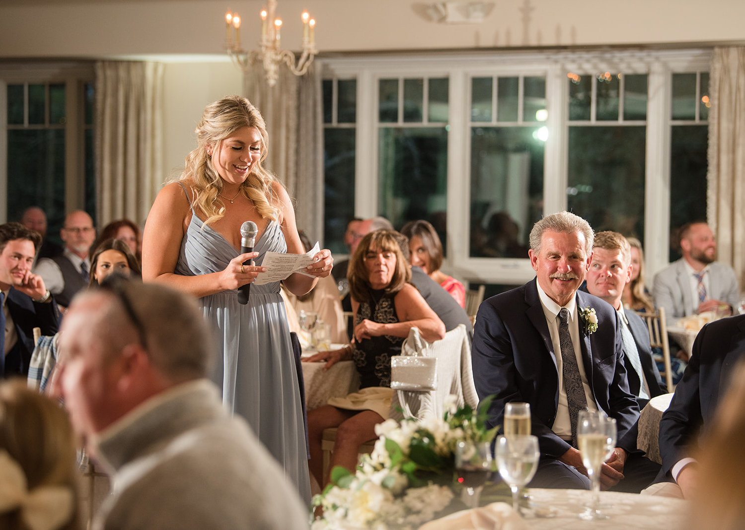 bridesmaid delivering her bridesmaid speech for the bride and groom