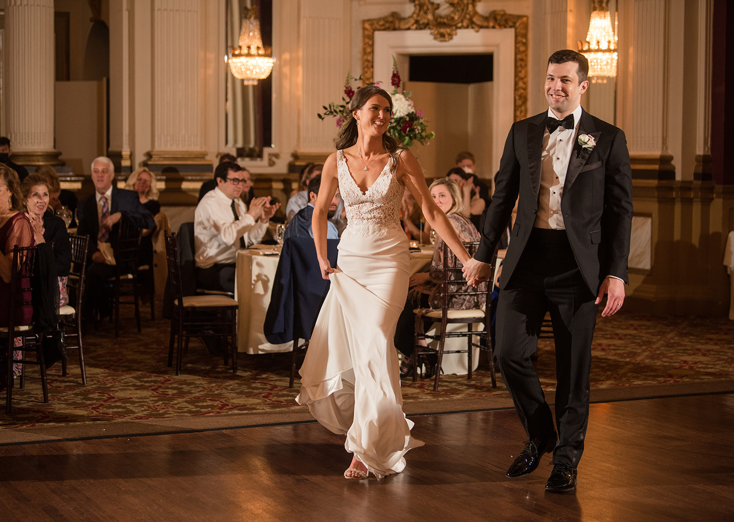 bride and groom make their grand entrance at their wedding reception